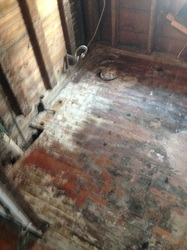 Bathroom gutted down to the studs during water damage restoration.